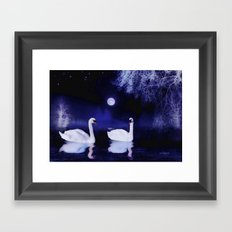 Swan lake at midnight Framed Art Print
