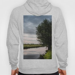 Green cottage at summer sunset Hoody