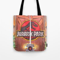 jurassic park Tote Bags featuring Jurassic Park by Humble Dino