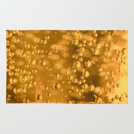 Golden water bubbles closeup macro with blurry effects Rug