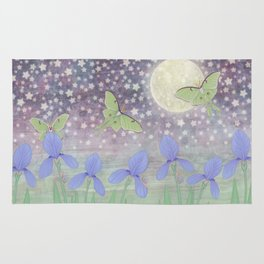 luna moths around the moon with starlit irises Rug