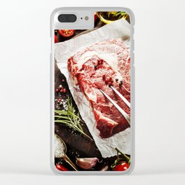 Raw beef steak with meat fork and ingredients on wooden background Clear iPhone Case