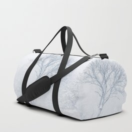 Lonely tree during snow storm in winter Duffle Bag