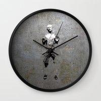 han solo Wall Clocks featuring Han Solo Carbonite by Inara