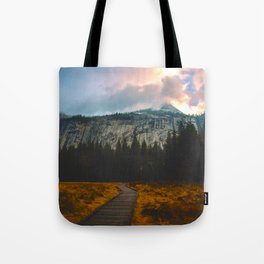 Path leading to Mountain Paradise Mountain Snow Capped Pine trees Tall Grass Sunrise Landscape Tote Bag