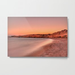 Sunset at a wild beauty beach with eaten by the sea cliffs and unique caves in Karpathos, Greece Metal Print