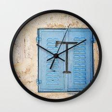 Vibrant Blue Window in Stone Wall Wall Clock