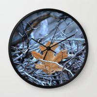 introvert Wall Clocks featuring introvert by Lisa Carpenter