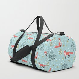 Red foxes in the blue winter forest with snow Duffle Bag