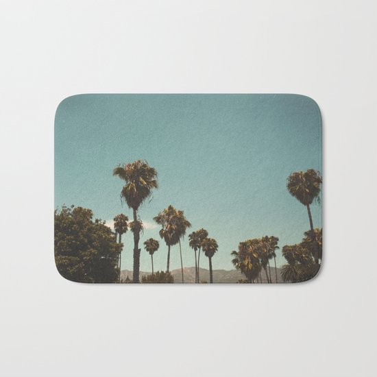 Palm trees before the mountain foot Bath Mat