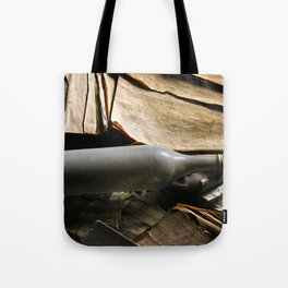 bottle and books Tote Bag