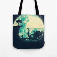 solid Tote Bags featuring The Big One by Jay Fleck