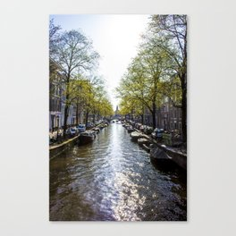 Sun Shining on a Row of Spring Trees Lining the Keizersgracht Canal in Amsterdam, Netherlands Canvas Print