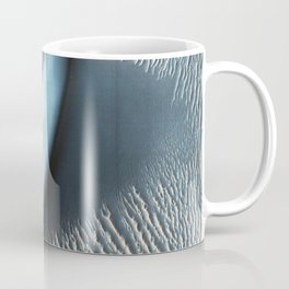 Nili Fossae layered bedrock as horizontal striations in the light toned sediments in the floor of a Coffee Mug