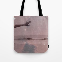 Across the sea of space, the stars are other suns Tote Bag