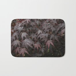 Water droplets on Acer leaves Bath Mat