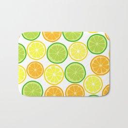 Citrus Slices on White Bath Mat