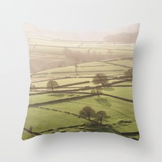 Hazy light at sunset over a valley of fields. Derbyshire, UK. Throw Pillow