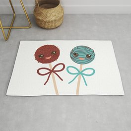 cute funny kawaii chocolate and blue Sweet Cake pops set with bow on white background Rug