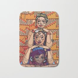 Three african woman in traditional clothing, holding each other heads Bath Mat