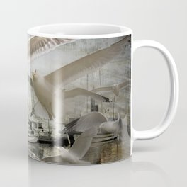 Gulls moving amidst Boats in a foggy harbor Coffee Mug