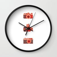 cameras Wall Clocks featuring Cameras by madelyn bilsborough