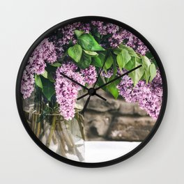 Romantic photo composition with lilac and vintage book on white lace tablecloth. Wall Clock