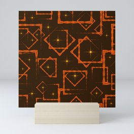 Orange rhombuses and squares in intersection with yellow stars on a brown background. Mini Art Print