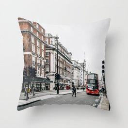 Red bus in Piccadilly street in London Throw Pillow