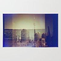 toronto Area & Throw Rugs featuring Toronto by Jordan Osbourne