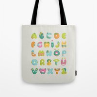 alphabet Tote Bags featuring alphabet by lalehan canuyar
