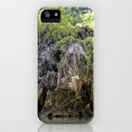 Ancient Boulder Covered in Lush Green Plants in the Turquoise Water of Halong Bay, Vietnam iPhone Case