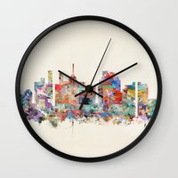 north carolina Wall Clocks featuring raleigh north carolina by bri.buckley