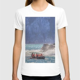 Small boat and waves crashing over rocks T-shirt