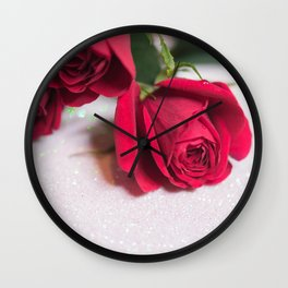 Roses over abstract background with bokeh defocused lights Wall Clock