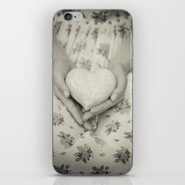 Heart in her hands iPhone Skin