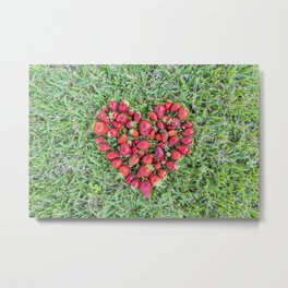 Heart made of strawberries with grass in the background Metal Print