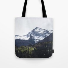 Winter and Spring - green trees and snowy mountains Tote Bag