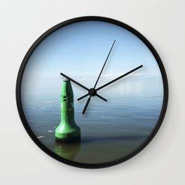 Green buoy foating in smooth blue ocean Wall Clock