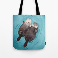 otters Tote Bags featuring Otterly Romantic - Otters Holding Hands by When Guinea Pigs Fly