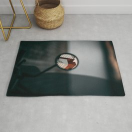 BLACK MAGNIFYING GLASS ON BLACK TABLE Rug