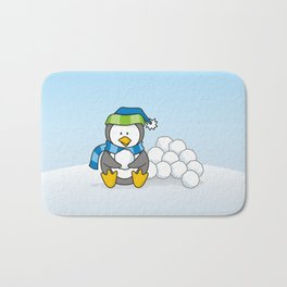 Little penguin sitting with snowballs Bath Mat