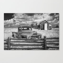 Black and White of Rusted International Harvester Pickup Truck behind wooden fence with Red Barn in Canvas Print