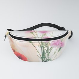 pink flower and orange flower in the vase with curtain background Fanny Pack