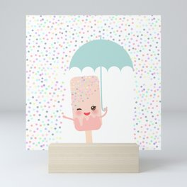pink ice cream, ice lolly holding an umbrella. Kawaii with pink cheeks and winking eyes Mini Art Print