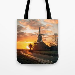 Typical Dutch mill Holland The Netherlands during sunrise Tote Bag