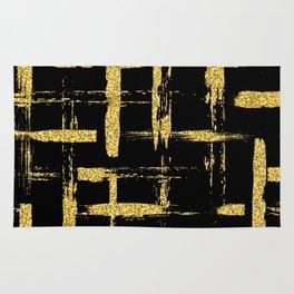 Gold glitter brush on black Rug