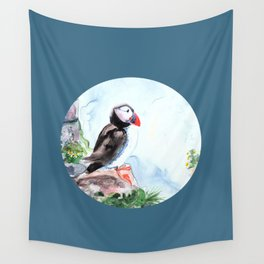Puffin sitting on a rock with a blue background Wall Tapestry