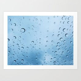 Drops of water on a glass, on a blue background Art Print
