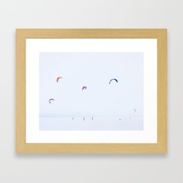 Snowkiting on snowy and icy lake Framed Art Print